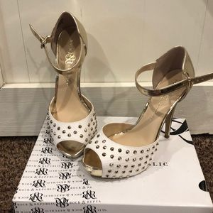 White and gold studded high heels